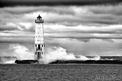 Whisked Light - Frankfort North Breakwater Lighthouse (Frankfort, MI) (Aaron C. Jors) Tags: bw blackwhite lighthouses waves michigan lakemichigan greatlakes maritime storms stormclouds uppermichigan michiganlighthouses benziecounty greatlakeslighthouses lakemichiganlighthouses frankfortlighthouse frankfortnorthbreakwaterlighthouse