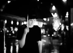 shelter   bronica etrs 645 medium-format film   75mm f/2.8 zenzanon pe-II   kodak portra 800 @ iso 1600 (*AndrewYoungPhoto* (writing_with_glass)) Tags: street city boy portrait blackandwhite bw reflection male monochrome rain night umbrella portraits mediumformat reflecting utah blackwhite solitude alone loneliness quiet bokeh streetphotography lifestyle calm dreaming 120film depthoffield story teen saltlakecity portraiture thinking ennui mf lonely melancholy cinematic 6x45 contemplative stillness manualfocus narrative pondering iso1600 nightstreet storytelling nightportrait daydreaming musing shallowdepthoffield reverie shallowdof selectiveblur mediumformatfilm candidportraits writingexercise bronicaetrs 1push nightportraits 75mmf28 mediumformat120 645film kodakportra800film citycreekmall blurrybydesign zenzanon75mm28peii writingwithglass andrewyoungphotonet copyrightandrewlyoung etrsnotetrsi posted20130624 pleaseignorepriortagapologiesneverletobnoxiousfriendsontoyourcomputerdeletingfrommypostsoneatatimegah webonlinemediacolorgamutoutput