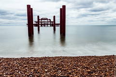 West Pier. [Explore] (Ollie Smalley Photography  Travelling) Tags: ocean old sea sky west beach water metal clouds canon fire photography grey coast pier kent rust brighton long exposure flat south sigma pebbles calm east ollie explore burnt le 20mm splash posts 1020mm milky derelict 19th smalley explored 550d t2i