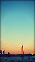 Moon Over the light (tark9) Tags: blue sky copyright lighthouse color tower water clouds port sunrise harbor buffalo lighthouses landmark historic greatlakes explore erie 1914 navigation allrightsreserved wny bulkcarrier 1833 buffaloriver decomissioned octagonal interesing greatlakeslighthouse westernewyork aidtonavigation lighthousetrek bottlelight buffalomainlight coastgaurdstationbuffalo buffalonaigara copyrightjasonkeklak