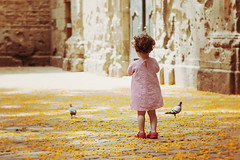 If you carry your childhood with you, you never become older. (Itziar Aio) Tags: barcelona flowers flores childhood yellow pigeons nia amarillo littlegirl palomas nena magicmoment momentomgico flowersonthefloor