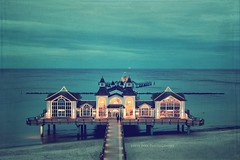 Sellin Pier (Juste Pixx) Tags: ocean blue sea sky painterly clouds vintage germany dawn lights pier balticsea retro dreamy ostsee textured sellin canon6d