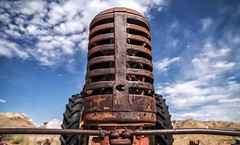tractor (Eddy Alvarez) Tags: machine engine grill rust old abandoned deserted west desert sky outdoor tires farm sharpness zeiss milvus 21mm nikon d810 arizona page