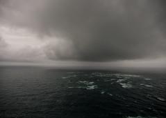 Cape Reinga (hmxhm) Tags: newzealand clouds olympus pacificocean tasmansea farnorth aotearoa capereinga