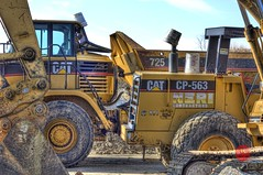 Big Cats sleeping (Mark Kaletka) Tags: cat canon illinois construction equipment paintshoppro batavia fermilab hdr highdynamicrange fermi xsi corel caterpiller photomatixpro 450d topazadjust