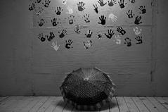 A rainy day (Catch the dream) Tags: bw stilllife usa art monochrome wall umbrella blackwhite rainyday unitedstates tn tennessee rainy prints impressions bnw handprints