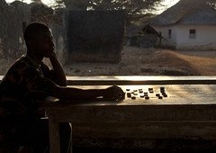 Player Contemplative In Front Of Checkerboard, Lamu, Kenya (Eric Lafforgue) Tags: africa game island photography kenya african chess culture unescoworldheritagesite afrika tradition lamu swahili afrique eastafrica qunia lafforgue traveldestination  qunia  122201   kea   tradingroute a