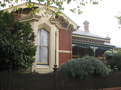 """Clowance"", a Late Victorian Villa - Ballarat (raaen99) Tags: city windows chimney brown house building tree brick home window leaves stone architecture facade fence garden post painted name cement 19thcentury decoration australia victoria carving tiles victoriana woodenfence villa castiron slate verandah residence housename roofline pediment eaves gable ballarat goldrush picket 1893 redbrick ornamentation nineteenthcentury picketfence 1890s 1892 sashwindow valance countryvictoria baywindow gardenfence domesticarchitecture victorianera newelpost clowance gingerbreading goldrushera brickandstone renderedbrick slaterooftiles cementrender provincialvictoria boomstyle architecturallydesigned boomstylearchitecture hippedgable timbervalance raisedpediment clowancehouse isaiahpearce wegribble tudorstylechimney dichromaticbrick"
