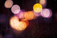 I only wanted to see you underneath the purple rain. (Lidia Camacho) Tags: street wet glass rain yellow night canon 50mm lights luces drops lluvia purple bokeh violet prince gotas rainy dominicana 12 cinematic domingo santo santodomingo llueve mojado morado 12l 50mm12l