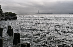 The view from the South Cove Tuesday afternoon. (Jay Fine) Tags: nyc storm sol water clouds manhattan hudsonriver pilings statueofliberty batteryparkcity southcove dadrosesscovefisheyenightharbor