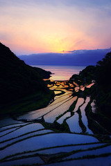 Twilight Hourglass (www.jasonarney.com) Tags: ocean blue sunset sun water japan spring twilight rice dusk farm  bluehour ricefield saga   kyushu  riceterrace           southjapan genkaitown jasonarney japanscapes soakedricefield shelvedricefield stackedricefield