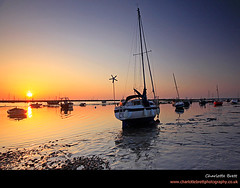 Mersea fishing boats (Charlotte Brett Photography) Tags: sunset sea england boats coast fishingboats essex mersea