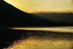 Lake Scanno at dusk (Mario Ottaviani Photography) Tags: travel sunset italy mountain lake nature landscape freedom italia tramonto peace view dusk scenic tranquility calm adventure serenity vista serene exploration tranquil breathtaking paesaggio abruzzo scanno naturallandmark elevatedview sonyalpha marioottaviani