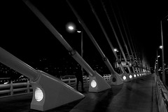 Night city (Daniel Nebreda Lucea) Tags: night noche bridge puente people gente andar andando walk walking shadows sombras city ciudad urban urbano modern moderno architecture arquitectura building construccin estructura structure light luz path camino spain valencia canon black white blanco negro lines lineas composicion composition a3b