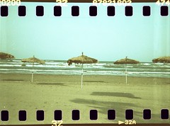 Under your umbrella (Plain Bananas) Tags: sea summer sky cold love beach umbrella river lomo xpro lomography sand poetry poem waves time under knife cyprus your bones dianaf maryoliver larnaca sprocket mackenziebeach larnaka rihanna   underyourumbrella coldpoem