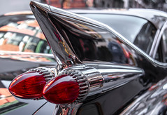 Tail Fin & Bullet Lights in Little Italy (Bob Jagendorf) Tags: auto old nyc red newyork car lights tail cadillac bullet littleitaly caddy