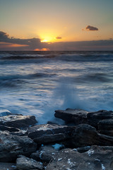 Seafoam Sunrise (John Cothron) Tags: ocean cloud seascape beach water rock seashells sunrise 35mm canon landscape dawn spring twilight sand unitedstates florida scenic wave windy atlanticocean saltwater ze seafoam lightr