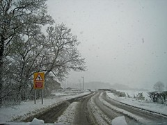 REDUCE SPEED NOW (RoystonVasey) Tags: road snow west car sign speed canon yorkshire ixus now 95 windscreen reduce