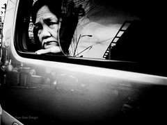 In Deep Thoughts [Explored] (Meljoe San Diego) Tags: bw window reflections philippines streetphotography oldlady van ricoh grd4 meljoesandiego