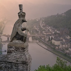 Neo-gothic Knight's Castle in Cochem rises above the Mosel (Bn) Tags: sunset sun sunlight mist castle history rain fog fairytale river germany point geotagged deutschland spring high topf50 coatofarms ray power view magic lion dream battle charm vineyards knights valley alemania knight layers neogothic schloss viewpoint topf100 epic defense cochem impressive steep mosel rheinlandpfalz moselle reichsburg moezel 100faves 50faves 1000ad animalsymbols reichburg rijksburcht keltenkeltiskceltiquegallic geo:lon=7168059 geo:lat=50147382