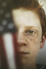 American Boy (Shelby Robinson) Tags: blue boy red portrait white face america canon hair rebel 50mm eyes memorial day close little flag american freckles f18 featuredonadidapcom t1i