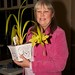 Cecily Bird with her orchid Cym. Cecily Bird