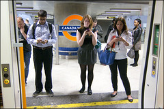 Distracted 1 (World of Tim) Tags: street camera canada london water sign mobile train canon underground mobiles tim doors photographer phone south under over platform may ground passengers rush hour commuter txt overground phones commuters compact distracted 2012 saunders texting s100 txting