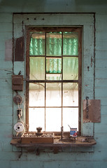 Someone's WIndow - Hawkinsville, GA (emilyearl) Tags: window collection scribbles gears spiderwebs cobwebs dilapidated bandaids writingonthewall windowpanes addressbook abandonedbelongings nikond300 hawkinsvillega emilyearlphotography