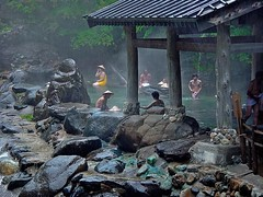 Bathing in the pouring rain   [Explored ]  #305 (JohnCramerPhotography) Tags: bridge people woman men water rain japan stone river japanese women bath asia hats towel onsen lantern bathing hotspring minakami openair downpour gunma  takaragawa tenugui   rotenburo konyoku   osenkaku  takaragawahotsprings