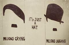 The wall makes an interesting point (Melissa Maples) Tags: white streetart art turkey graffiti nikon asia hitler trkiye antalya nikkor vr afs  charliechaplin 18200mm   f3556g  18200mmf3556g d5100 davidpeople