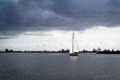Sailboat catching the light (lumofisk) Tags: light cloud holland water netherlands sailboat licht wasser harbour yacht outdoor shoreline wolke shore ufer hafen enkhuizen segelboot ijsselmeer draussen yawl 275mm nikon1aw1 1nikkoraw11275mmf3556