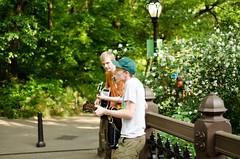 When your legs don't work... (barua.amartya) Tags: park centralpark nyc summer ny newyorkcity street photography ukulele guitar song musician