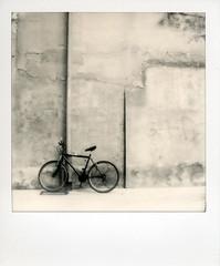 Bike (Valt3r Rav3ra - DEVOted!) Tags: street blackandwhite bw bike polaroid streetphotography biancoenero alessandria impossible polaroidsx70 instantfilm urbanvisions visioniurbane valt3r valterravera