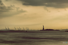 Statue of Liberty and Oil Rigs (skumar0108) Tags: park nyc longexposure bridge sunset newyork water statue clouds liberty island pentax dusk tripod oil sunrays bigapple rigs brookly ndfilter oilrigs brooklybridge sirui brooklybridgepark statueorliberty bigstopper tenstop pentaxk3