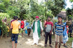 H504_3340 (bandashing) Tags: trees red england music men green manchester dance shrine branch village hill pray crowd sing sylhet bangladesh socialdocumentary mazar baul aoa shahjalal bandashing akhtarowaisahmed treecuttingfestival lallalshahjalal