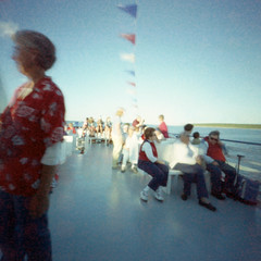 In the Boat Parade (Sean Anderson Media) Tags: summer 6x6 wisconsin mediumformat boat streetphotography pinhole lakemichigan 120film motionblur 4thofjuly doorcounty zeroimage boatparade onaboat zeroimage2000 lomographycolor100