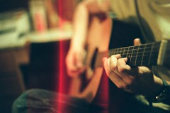 quiet (dimplyemily) Tags: film guitar fingers lightleak acoustic
