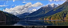 The Lions - Lake Capilano, BC (w4nd3rl0st (InspiredinDesMoines)) Tags: 2012 canon 5d 1740 travel spring mountain scenic panoramic panorama vista beautifulview lake reservoir lakecapilano lions thelions mountainrange mountainous vancouver city bc britishcolumbia canada reflection water tourism clevelanddam dam bluesky puffyclouds gorgeous view pano poster wallpaper computer screensaver desktop crisp clean snowcappedmountains snowy