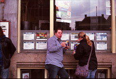 (futile81) Tags: street amsterdam 35mm husband fries wife potatoeaters