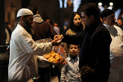 Vendor selling Traditinal Moroccan Cookies at Midnight in Marrakesh, Morocco (Simon Christiaanse) Tags: africa city people cookies beard market muslim streetphotography morocco midnight medina vendor marrakesh bazaar selling salesman moroccan traditinal  taqiyah simonchristiaanse