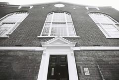 Truman Brewery Clock (goodfella2459) Tags: white black brick london history clock film analog 35mm lens jack nikon long elizabeth crime brewery lane annie 100 af nikkor whitechapel milf f4 truman chapman ripper 14mm f28d adox oldandbeautiful silvermax