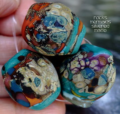 Rocks Mermaids Silvered Matte (Laura Blanck Openstudio) Tags: show blue roof red etched usa brown abstract brick green art glass set silver tile beads leaf big italian sand beige rocks colorful artist glow purple handmade stones eggplant teal maroon fine arts almond violet lavender plum sienna funky jewelry pebbles made odd caramel lilac honey earthy copper opaque bead organic mermaid kiln nuggets murano lampwork multicolor raku artisan matte whimsical loose frosted frit openstudio asymmetric ocher speckles tumbled silvered annealed openstudiobeads