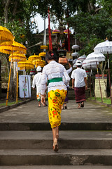 Woman walks up the stairs (Evgeny Ermakov) Tags: street travel decorations people bali woman white holiday tourism colors fashion yellow stairs umbrella indonesia asian temple holidays asia southeastasia candid traditional decoration young ceremony culture style scene newyear clothes celebration exotic destination ritual local southeast typical youngwoman cultural ubud touristic balinese nyepi dayofsilence editorialuse