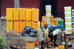 Jerry cans and buckets of ??? (10b travelling) Tags: container gerrycan ghana accra kumasi westafrica roadside road street photography afrique afrika goldcoast goldkueste britishempire colony jerrycan ctb cmtb tenbrink 10b carsten ten brink westafrika ouest africa peopleset 1000plus