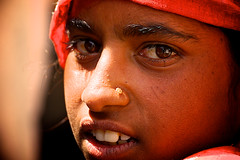 portrait of the girl in the red sari (Handheld-Films) Tags: travel red portrait people india hot face eyes asia warm candid indian documentary ruralrajasthan portraitsofindia indianportraits