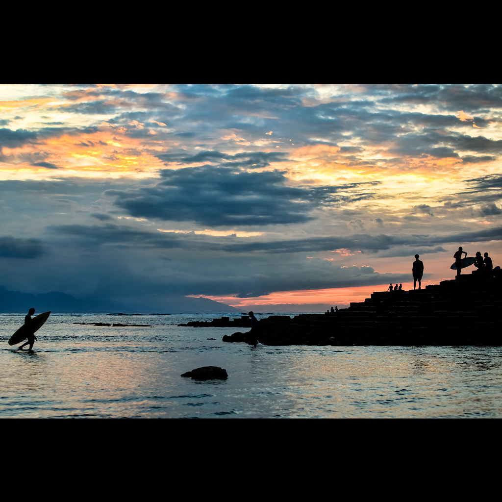 Surfing at Sunset, Senggigi, Lombok, Indonesia