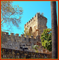 Typically Spanish! ('cosmicgirl1960' NEW CANON CAMERA) Tags: blue trees sky castle fruit spain stones palmtrees moorish costadelsol walls oranges orangetree marbella lampposts