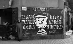 Crazy Boys (ronnieibrahim) Tags: street old travel blackandwhite bw man graffiti market billboard morocco marrakech