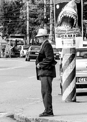 UNDER THE SHARK'S EYE (Galantucci Alessandro) Tags: street city trip portrait people urban blackandwhite bw italy white man black art monochrome hat contrast photography monocromo town blackwhite italian eyecontact europa europe strada fotografie gente candid sony streetphotography documentary east persone romania alb grainy fotografia bianco ritratto nero biancoenero est decisivemoment citt cluj clujnapoca contrasto oameni oras negru monocrom documentar albsinegru fotografiadistrada fotografiedestrada portretu documentaristica alessandrogalantucci