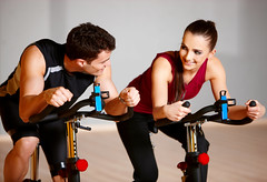 Couple at the gym (ComunicacionesAJE) Tags: two people woman man sexy girl loss beauty smile muscles bike sport female club train training happy person healthy couple slim ride adult exercise body spin young machine handsome equipment indoors health strong strength brunette diet shape workout fitness gym weight tracksuit fit sporty cardio active losing vitality